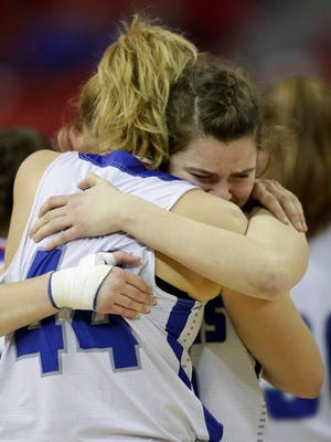 Amherst's Heather Pearson, left, and Lauren Boelte embrace after losing to Marshall in their Division 3 championship game at the WIAA state girls basketball tournament Saturday at the Resch Center in Ashwaubenon.