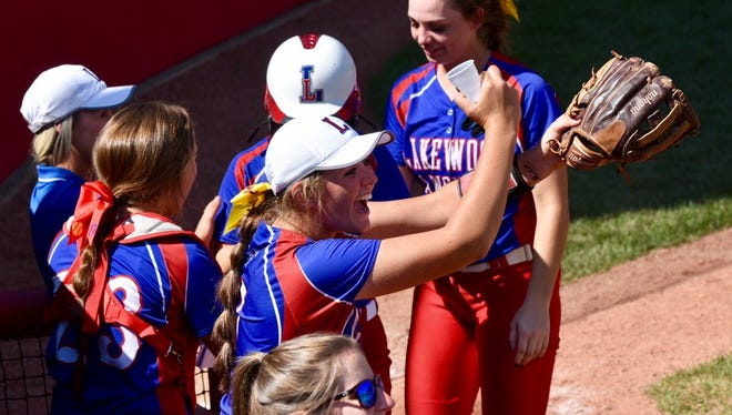 Lakewood pitcher Courtney Vierstra leads the dug out cheering during a two-out rally in the third inning at Akron's Firestone Stadium Friday during a Division II state softball semifinal.