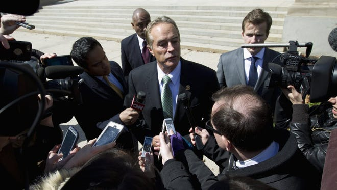 Rep. Chris Collins R-N.Y. speaks with reporters as he leaves a closed-door meeting with Republican presidential candidate Donald Trump, Monday, March 21, 2016, in Washington.