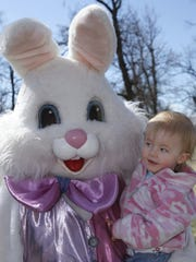 Nineteen-month-old Lily Johnson takes a close look at the Easter Bunny at the Fisher Radio and the City of Great Falls Recreation Department Easter egg hunt.