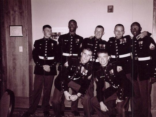 Zachary Cooper, bottom row right, in 2003 at the Marine Corps Birthday Ball in North Carolina. Zachary's friend kneeling beside him is Jeremiah Fisher, who was later a groomsman in Zachary's wedding.