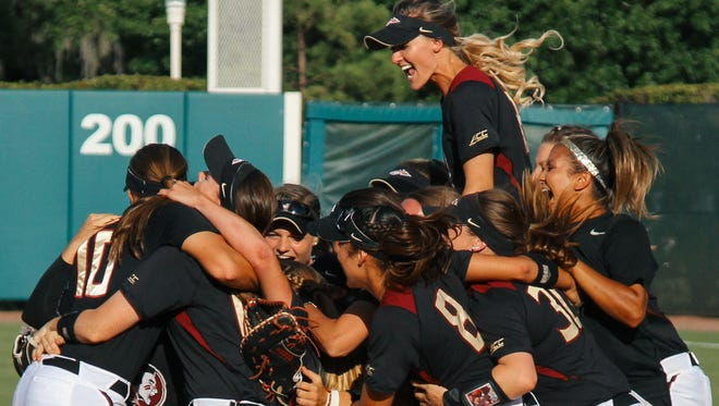 Florida State celebrates defeating the University of Utah 2-0 to advance to the Women's College World Series.