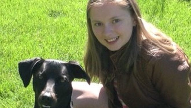 Erin Culbertson, 15, of Allouez, with the family dog, Nala. Culbertson, who was born with cystic fibrosis, recently underwent a double-lung transplant in St. Louis.