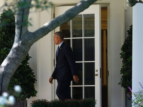 President Obama walks out of the Oval Office on Oct.