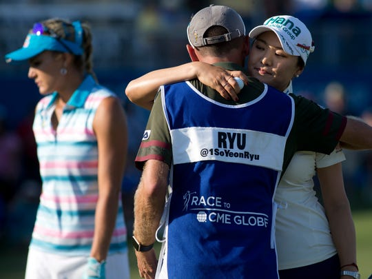 So Yeon Ryu of South Korea gives her caddie a hug during the CME Group Tour Championship at Tiburon Golf Club Thursday, Nov. 17, 2016 in Naples. Ryu finished tied for second after the first round with a score of five-under par.