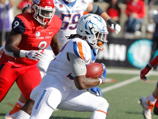 Boise State's running back Alexander Mattison heads downfield against Fresno State's Jeffrey Allison, left, during the first half of an NCAA college football game in Fresno, Calif., Saturday, Nov. 25 2017. (AP Photo/Gary Kazanjian)