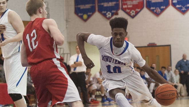 Mehki Greene of Washington Township makes his way past Lenape's Dylan Yerkes during the first half of Thursday's game.