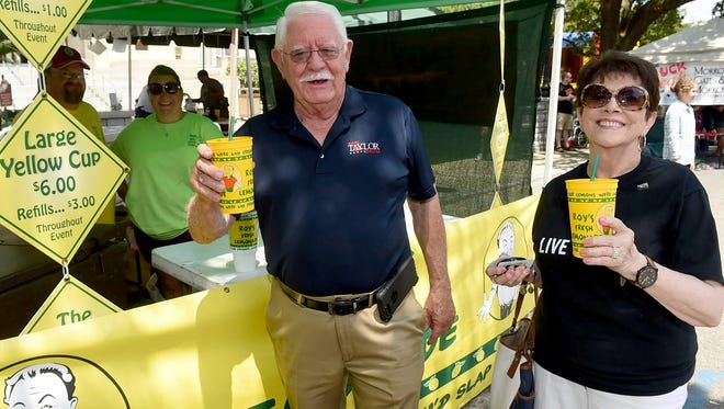 St. Landry Parish District Attorney Earl Taylor and Susie Peck enjoy an ice cold lemonade while taking in the activities at the  Comme Ci Comme Ca Yard Bird Cook-Off held Saturday in downtown Opelousas. The first annual event was sponsored by the St.Landry-Evangelne United Way. See more photos and a video at dailyworld.com and on the Daily World Facebook page.