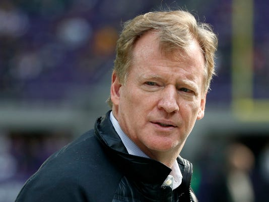 FILE - In this Oct. 15, 2017, file photo, NFL commissioner Roger Goodell watches from the sidelines before an NFL football game between the Minnesota Vikings and Green Bay Packers in Minneapolis. Goodell has signed a five-year contract extension to keep him as commissioner of the NFL through 2024. A memo from the NFL's compensation committee to team owners and obtained by The Associated Press confirms that Goodell and committee chairman Arthur Blank, owner of the Atlanta Falcons, have signed the extension. Goodell took over for Paul Tagliabue in 2006.  (AP Photo/Bruce Kluckhohn, File)