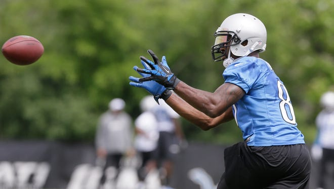 Detroit Lions wide receiver Calvin Johnson catches a pass during minicamp Wednesday, June 17, 2015, in Allen Park.