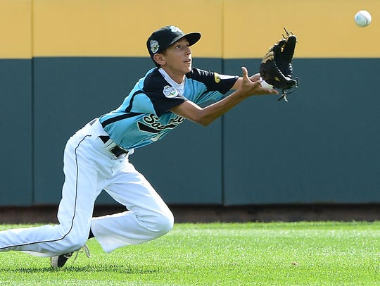 Goodlettsville center fielder Jayson Brown dives to