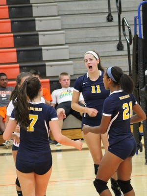 Walnut Hills junior Meredith Shaw leads the celebration after a point with senior Gabrielle Beyrer (7) and senior Janice Donaldson (21).