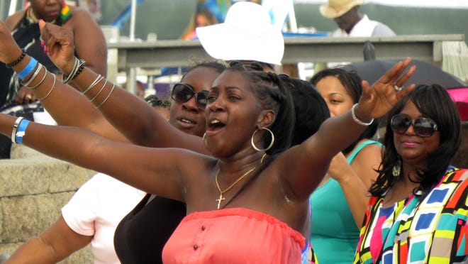 Fans get into the music of recording artist Tucka during Gulf Coast Summer Fest on Casino Beach.