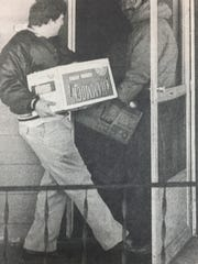 Steve Buchanan, left, and Paul Monsour, members of the Durbin Council Knights of Columbus, are shown delivering food to a needy family in Morganfield in December 1985. The KC's delivered 12 baskets of food to people in need that day.