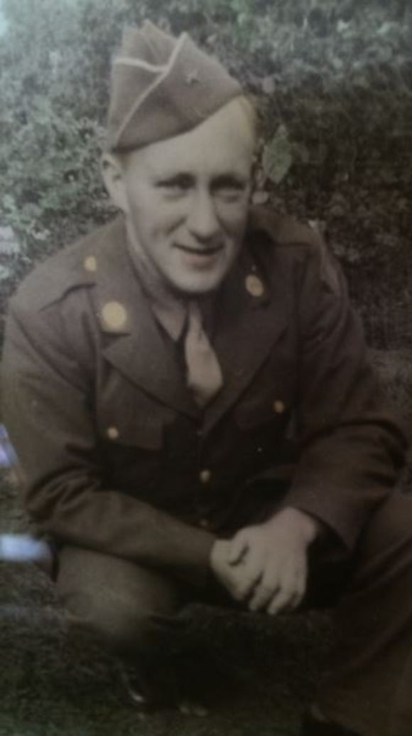 """Pfc. Wayne Clark crossed into Germany with the """"Rolling"""