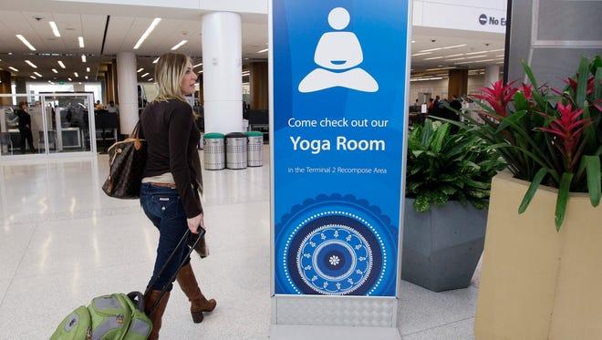 Traveler Maria Poole leaves San Francisco International Airport's yoga room Jan. 27, 2012.