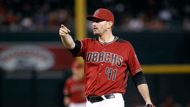 Arizona Diamondbacks pitcher Daniel Hudson motions for a video replay on an apparent go-ahead home run by San Diego Padres' Ryan Schimpf during the ninth inning of a baseball game, Sunday, Oct. 2, 2016, in Phoenix. The call on the field of a home run was overturned.
