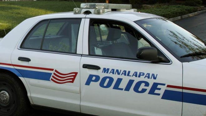 Jersey Central Power & Light Co. workers are on the scene of a downed utility pole, Manalapan police said. A Manalapan police car is seen in this 2006 file photo.