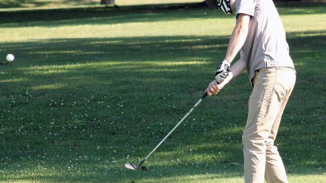 Annawan-Wethersfield's Austin Peck, wearing a mask, gets a chip shot on the No. 1 green on Thursday at Kewanee Dunes.