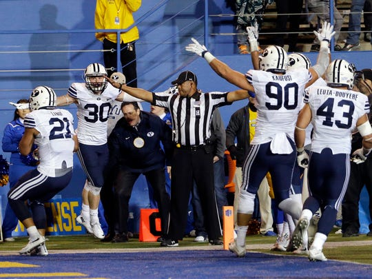BYU players celebrate after a failed two-point conversion by San Jose State in the closing seconds of an NCAA college football game Friday, Nov. 6, 2015, in San Jose, Calif. BYU won 17-16.