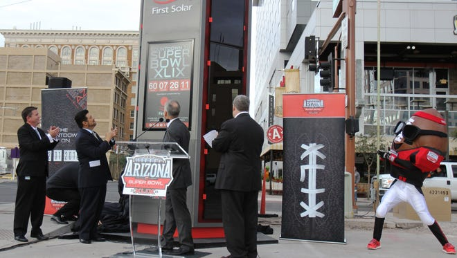 Arizona Super Bowl Host Committee officials unveiled the First Solar Countdown Clock on Dec. 3 at the northeast corner of 1st and Jefferson streets. The clock ticks down the days, hours, minutes and seconds until Super Bowl XLIX on Feb 1, 2015.