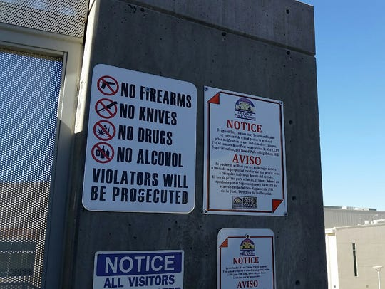 A sign listing prohibited items, including firearms,