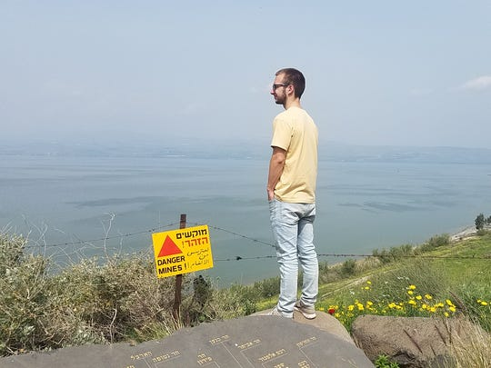 Ford Williams, son of columnist Ben Williams, looks out over the Sea of Galilee in Israel in March.
