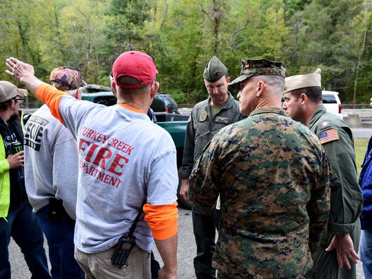 Military officers arrive near where a U.S. Navy plane from Meridian, Mississippi, crashed Sunday, Oct. 1, 2017, in the Cherokee National Forest in Tellico Plains.