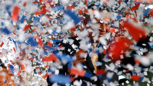 Confetti falls around Gov. John Kasich at his presidential primary election rally in Berea, Ohio, on Tuesday, March 15, 2016. (AP Photo/Matt Rourke)