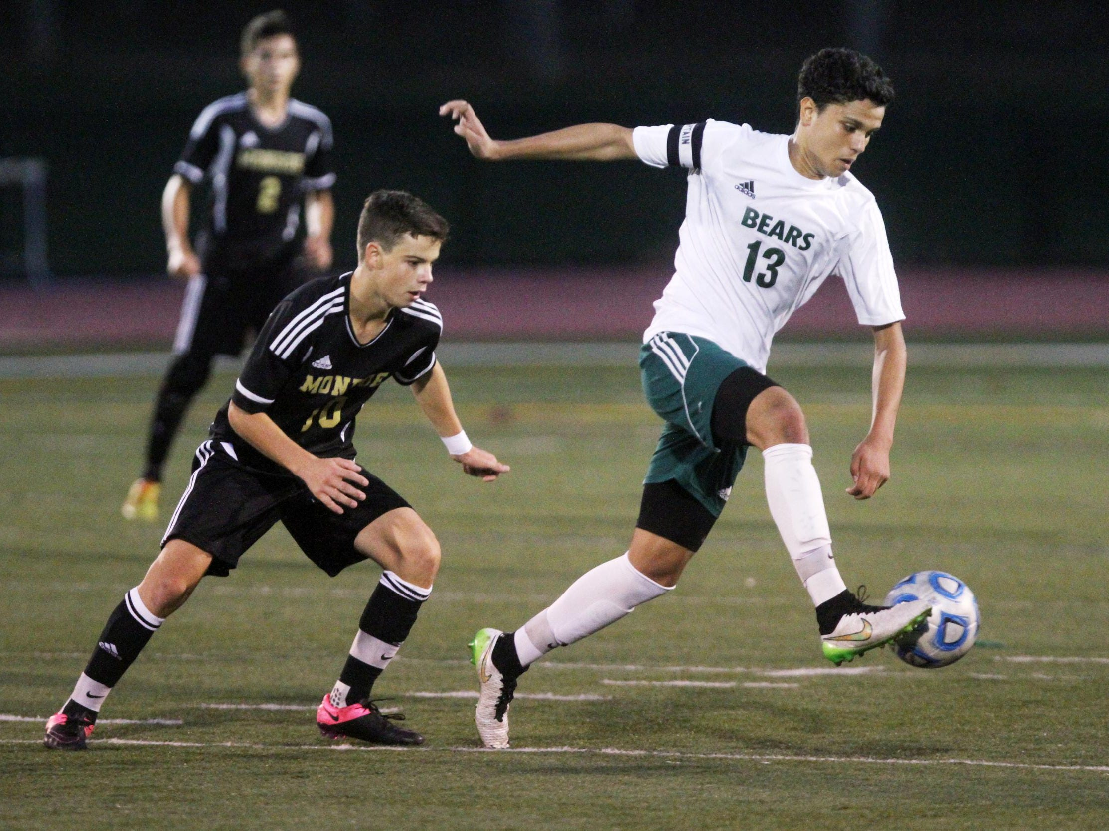 East Brunswick's Mohamed Fquihi kicks in front of Monroe's Alex Fernandez on Thursday in East Brunswick.