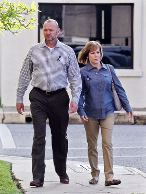 Kevin and Renee Miller Rivault, the parents of Austin Rivault, arrive at the Lafayette Parish Courthouse Tuesday, March 17, 2015, in Lafayette, La.
