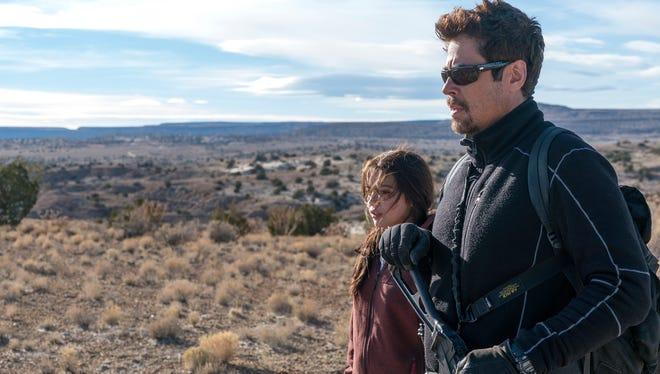 """Benicio Del Toro, right, and Isabela Moner in """"Sicario: Day of the Soldado."""""""