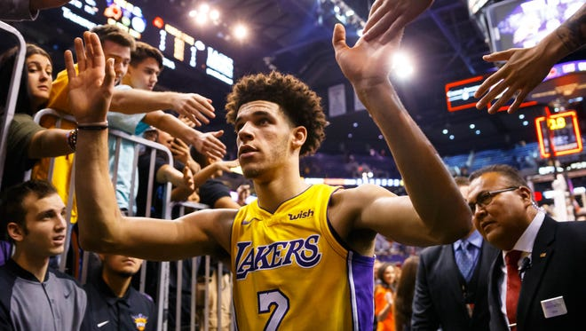 Lonzo Ball greets fans after a game.