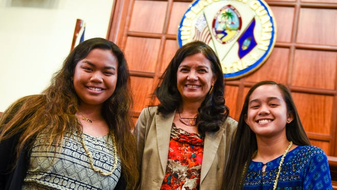 Vice Speaker Therese Terlaje, center, stands with her youth counterpart, Notre Dame High School junior Courtney Buendicho, left, and her youth Policy Analyst Aubrey Magdalera, a seventh-grader from Bishop Baumgartner Memorial Catholic School, at the Guam Legislature on Wednesday, April 18, 2018.
