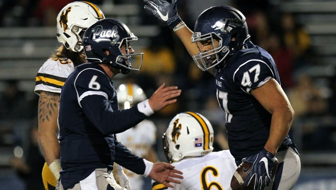 Quarterback Ty Gangi, left, and tight end Jarred Gipson celebrate a touchdown in a loss to Wyoming.