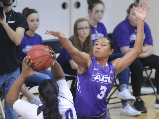 ACU's Dominique Golightly, right, defends against Central