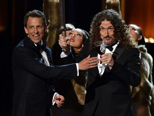 """Weird Al"" Yankovic, right, banters with host Seth Meyers at the 2014 Emmy Awards."