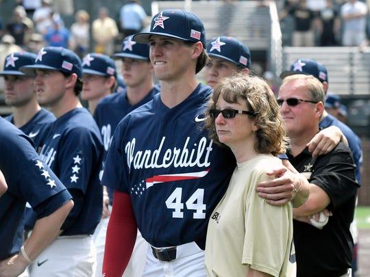 Vanderbilt baseball player Kyle Wright (44) embraces
