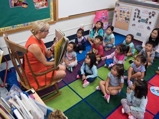 Former Florida First Lady Ann Scott reads to a group of pre-kindergarten students at the McMillian Pre-K Center in Pensacola on Oct. 2, 2017. The school board has voted 4-1 to transfer classes, teachers and support staff out of the center as a means of covering a district partner's $500,000 budget shortfall.