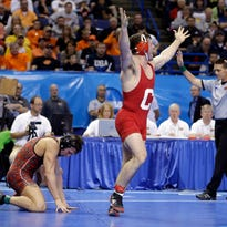 Cornell's Gabe Dean celebrates his 4-3 victory over Edinboro's Victor Avery in their 184-pound semifinal match at the NCAA Division I Wrestling Championships on Friday in St. Louis. Dean defeated Lehigh's Nathaniel Brown on Saturday for the title.