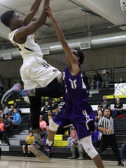 Dee Smith, left, puts up a short-range shot while being guarded by Jakeem Wynn. Alamogordo eliminated Clovis 68-59 at the Tiger Pit on Tuesday night.