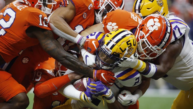 LSU wide receiver Justin Jefferson is tackled by Clemson during the first half of a NCAA College Football Playoff national championship game Monday, Jan. 13, in New Orleans.
