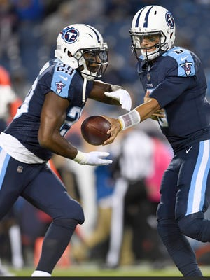 Titans quarterback Marcus Mariota (8) hands off to running back DeMarco Murray (29) during warmups before the game against the Colts at Nissan Stadium Monday, Oct. 16, 2017 in Nashville, Tenn.