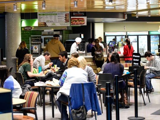 Binghamton University students fill up the new Market