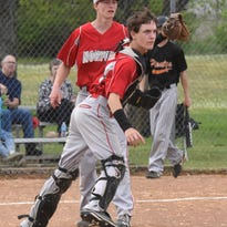 Norfork catcher Joseph Langston throws to first for an out during a recent game at Calico Rock, while pitcher Wyatt Chapman backs up the play. The Panthers defeated the Pirates 13-5 in district tournament play Thursday night at Viola.