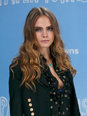 """Cara Delevingne attends the """"Paper Towns"""" Photocall at The Corinthia Hotel on June 18, 2015 in London, England."""