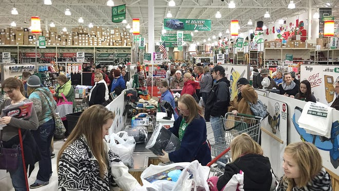 Shoppers swarm checkout lines around 7 a.m. Friday at Menards in Waite Park.
