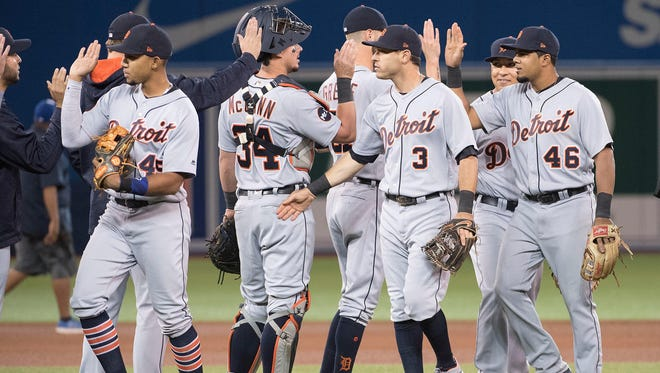 Tigers second baseman Ian Kinsler (3) celebrates the win with catcher James McCann (34) at the end of the ninth inning of the Tigers' 5-4 win on Friday, Sept. 8, 2017, in Toronto.