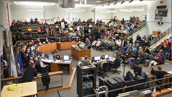 Citizens speak during public hearing on a proposed tobacco sales ordinance Monday, Nov. 6, during the St. Cloud City Council meeting at city hall.