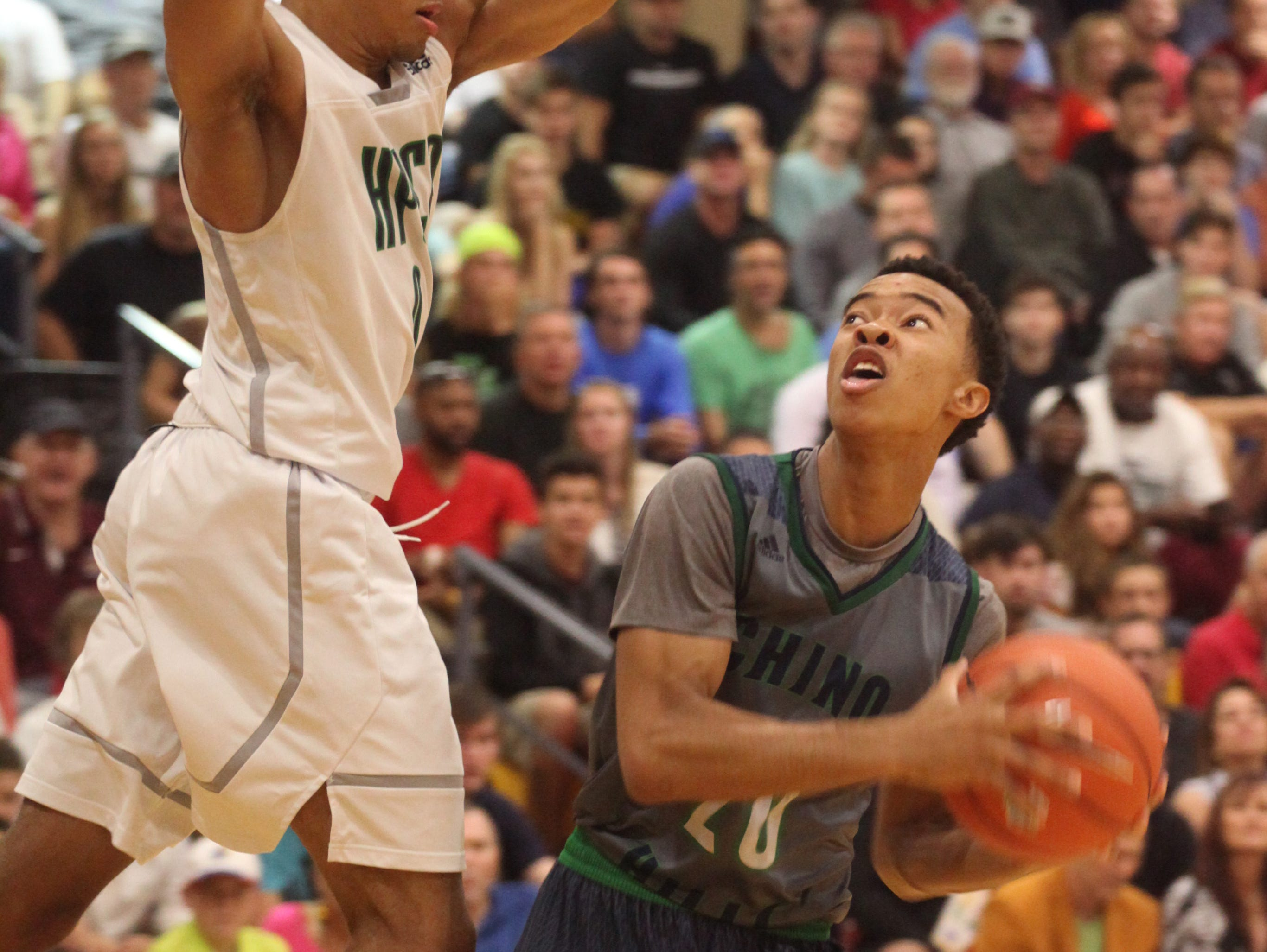 Chino Hills' Cameron Shelton waits for High Point Christian Academy's Ty Graves to clear the basket while looking for a shot during the City of Palms Semifinal on Tuesday night.
